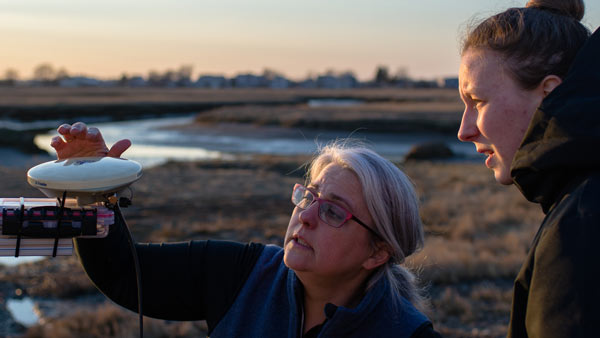 UNH CEPS professor and student conducing research