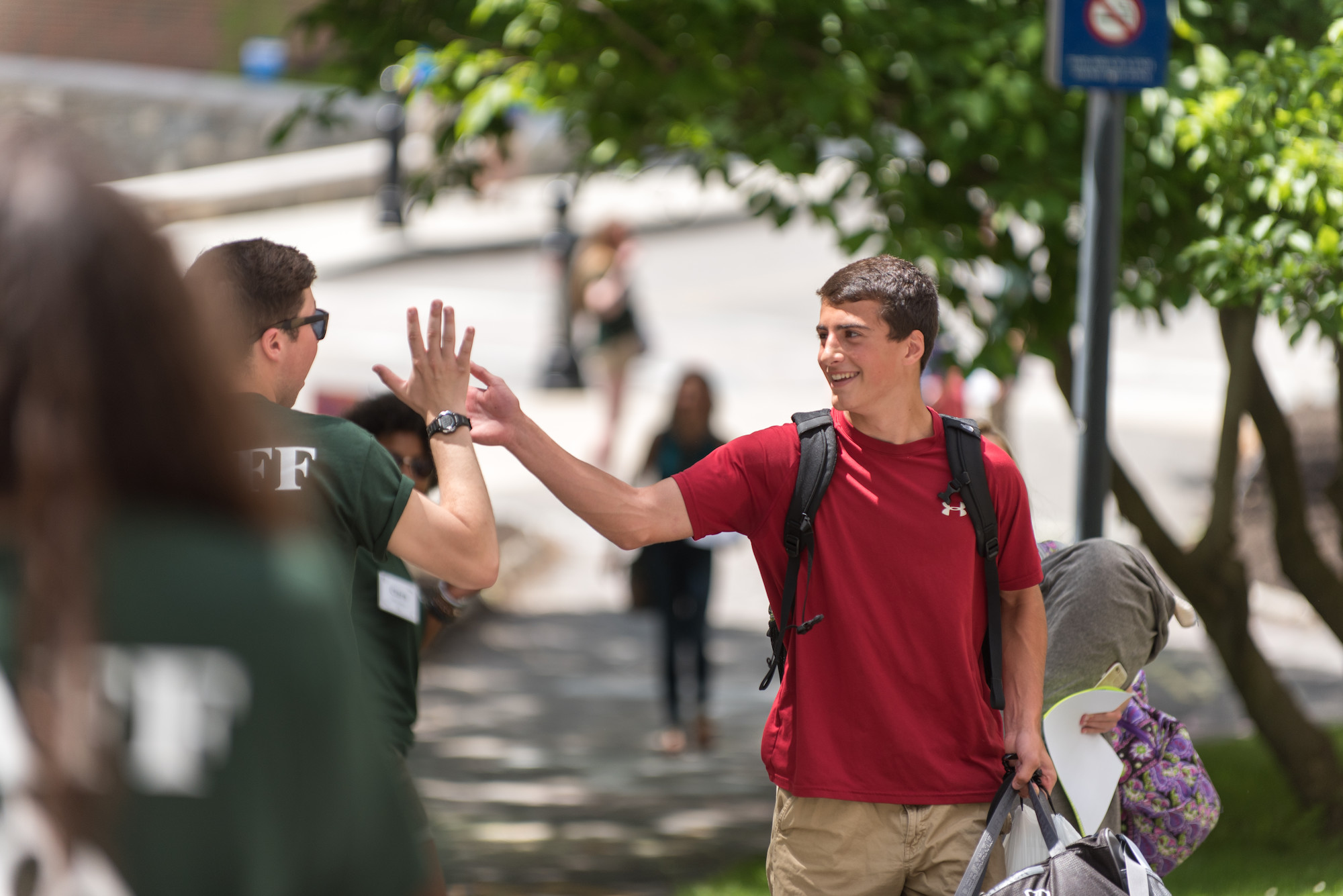Students high-five on move-in day at UNH.