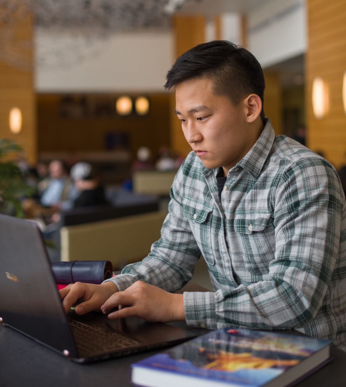 international student at laptop